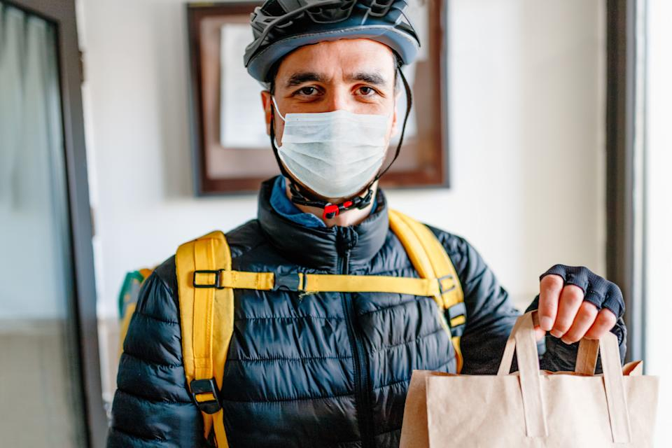 Tip delivery workers what you can. If you're in a financial position to do, add more of a gratuity than you would otherwise. (Photo: Phynart Studio via Getty Images)