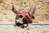 Anouk Verge-Depre, right, of Switzerland, and teammate Joana Heidrich celebrate winning a women's beach volleyball match against Brazil at the 2020 Summer Olympics, Tuesday, Aug. 3, 2021, in Tokyo, Japan.