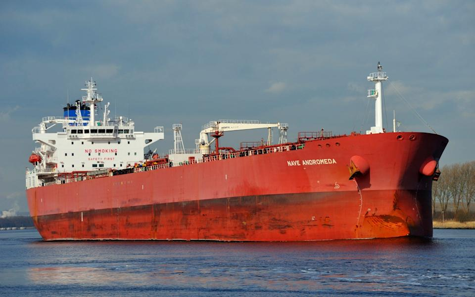 The tanker the Nave Andromeda is pictured on the Noordzeekanaal in the Netherlands in this image taken on April 3, 2014. British police and coast guard units responded Sunday Oct. 25, 2020, to an incident on the oil tanker in the English Channel after the crew reported they had stowaways onboard who had become verbally abusive. The incident, which began about 10 a.m. on the Libyan-registered tanker Nave Andromeda, was continuing Sunday evening. The coast guard scrambled two helicopters to the scene, and authorities imposed a three-mile exclusion zone around the vessel. (Lammert Melk via AP) - Lammert Melk/AP