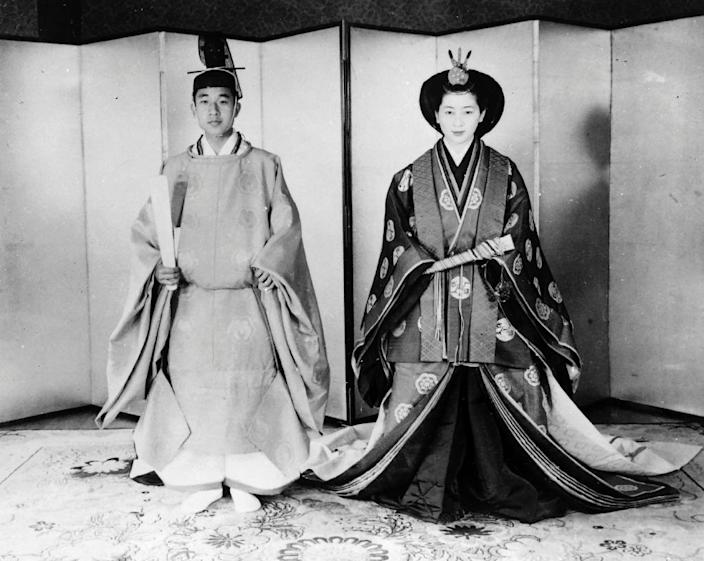 Then Prince Akihito and his wife Michiko Shōda pose in traditional wedding dress at their marriage at the Imperial Palace in Tokyo in 1959 (AFP Photo/STR)