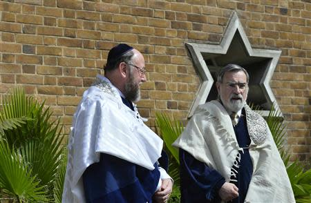 Chief rabbi, Jonathan Sacks, and chief rabbi-designate, Ephraim Mirvis, wait for Prince Charles to attend the installation of Mirvis as chief rabbi, at St John's Wood Synagogue in London