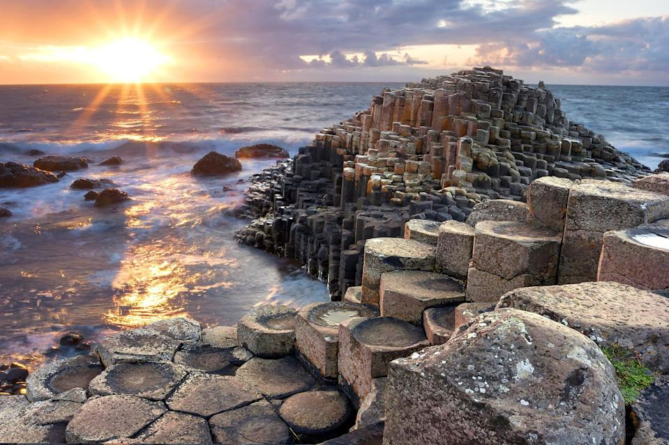 """<p>As you head out of Belfast, be sure to stick to Co. Antrim's northern coastline. It's astoundingly beautiful and you can make stops at attractions like <a href=""""https://www.nationaltrust.org.uk/giants-causeway"""" class=""""link rapid-noclick-resp"""" rel=""""nofollow noopener"""" target=""""_blank"""" data-ylk=""""slk:Giant's Causeway"""">Giant's Causeway</a> (pictured), the <a href=""""https://www.nationaltrust.org.uk/carrick-a-rede"""" class=""""link rapid-noclick-resp"""" rel=""""nofollow noopener"""" target=""""_blank"""" data-ylk=""""slk:Carrick-a-Rede rope bridge"""">Carrick-a-Rede rope bridge</a>, Bushmills distilery, and Dunluce Castle.</p>"""