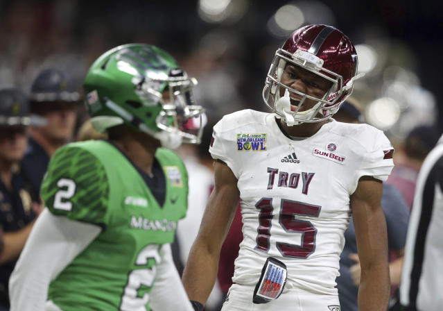 "Troy wide receiver <a class=""link rapid-noclick-resp"" href=""/ncaaf/players/276012/"" data-ylk=""slk:Damion Willis"">Damion Willis</a> (R) celebrates a pass reception over North Texas defensive back <a class=""link rapid-noclick-resp"" href=""/ncaaf/players/235621/"" data-ylk=""slk:Eric Jenkins"">Eric Jenkins</a> (2) in the first half of the New Orleans Bowl. (AP Photo/Gerald Herbert)"