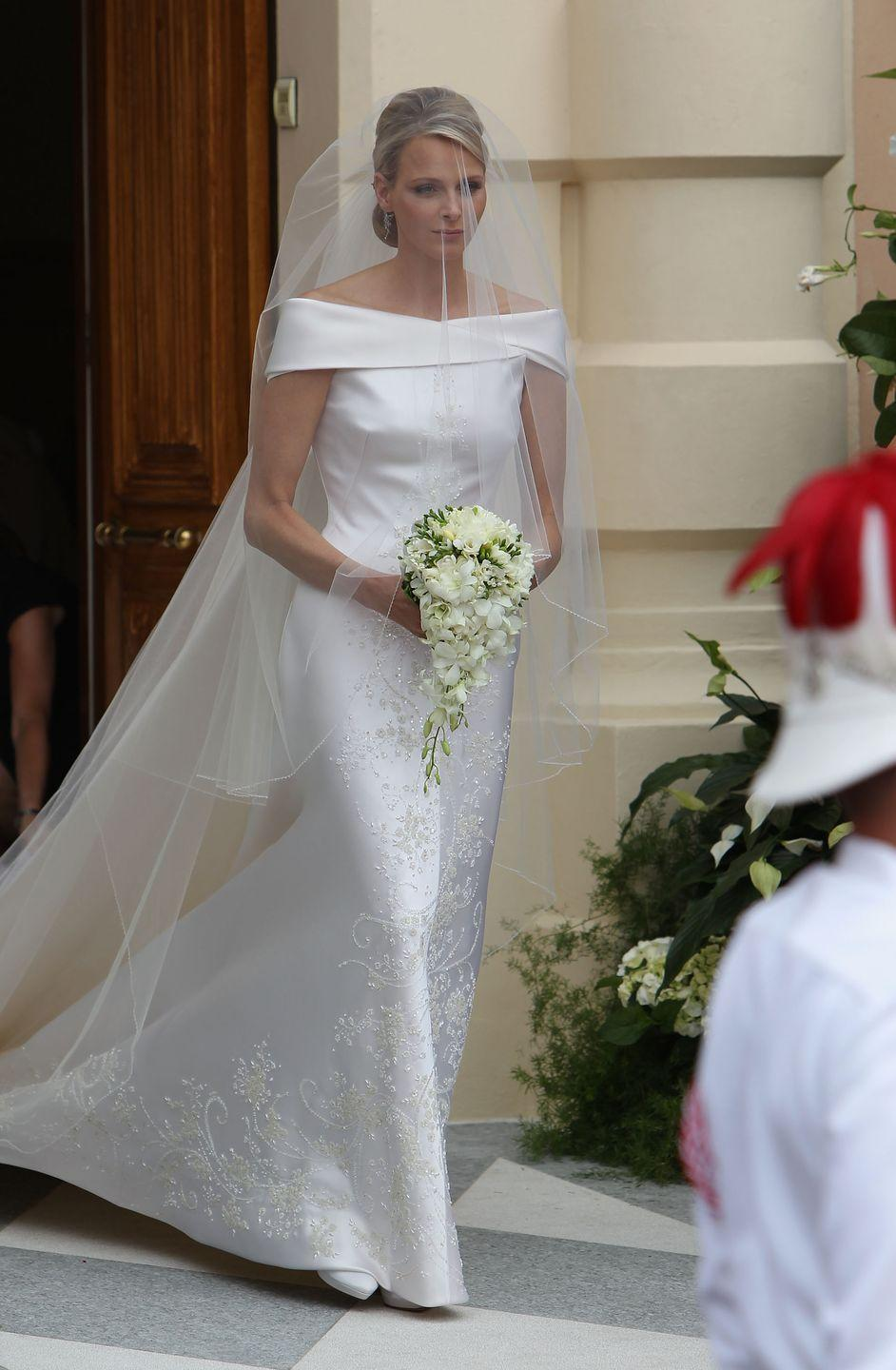 <p>Princess Charlene chose a custom off-the-shoulder duchesse silk gown by Giorgio Armani Privé for her religious ceremony to Prince Albert of Monaco. </p>