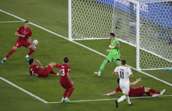 Turkey's Merih Demiral, left, scores an own goal during the Euro 2020 soccer championship group A match between Turkey and Italy at the Rome Olympic stadium, Friday, June 11, 2021. (AP Photo/Andrew Medichini, Pool)
