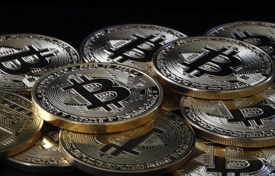 "PARIS, FRANCE - APRIL 14: In this photo illustration, a visual representation of the digital cryptocurrency, Bitcoin is on display on April 14, 2021 in Paris, France.  The value of bitcoin (BTC) has exceeded the threshold of 64,000 dollars for the first time in history.  The cryptocurrency is ahead of the British pound to become the 6th largest currency in the world.  The total bitcoin market is now $ 1<div class=""e3lan e3lan-in-post1""><script async src=""//pagead2.googlesyndication.com/pagead/js/adsbygoogle.js""></script>