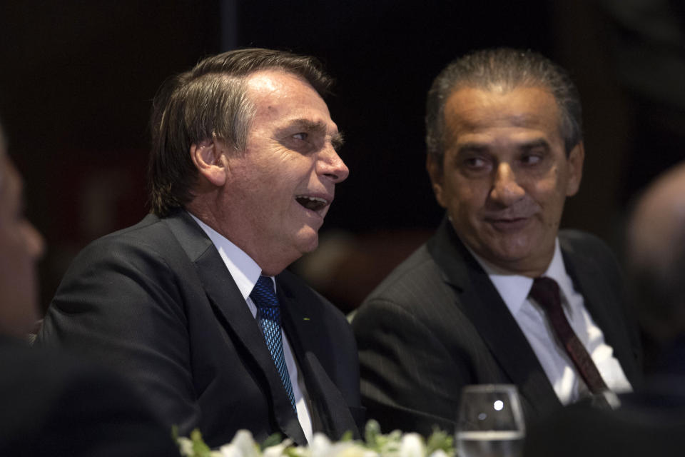 Brazilian President Jair Bolsonaro and Brazilian Congressman and Bishop Silas Malafaia (R) attend a meeting with evangelical leaders at the Hilton Barra Hotel, in Barra da Tijuca neighborhood, Rio de Janeiro, Brazil on April 11, 2019. (Photo by Mauro Pimentel / AFP)        (Photo credit should read MAURO PIMENTEL/AFP via Getty Images)