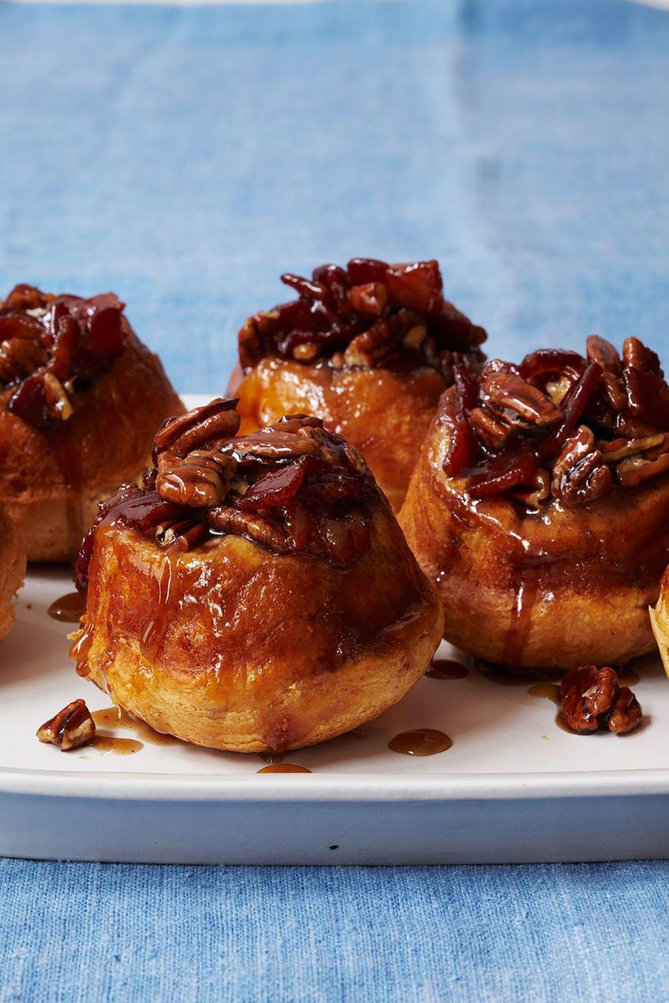 """<p>If Mom loves sweet<em> and</em> salty, she'll love these sticky buns. </p><p><a href=""""https://www.womansday.com/food-recipes/food-drinks/recipes/a12081/maple-bacon-pecan-buns-recipe-wdy0912/"""" rel=""""nofollow noopener"""" target=""""_blank"""" data-ylk=""""slk:Get the recipe for Maple, Bacon, and Pecan Sticky Buns."""" class=""""link rapid-noclick-resp""""><em>Get the recipe for Maple, Bacon, and Pecan Sticky Buns.</em></a> </p>"""