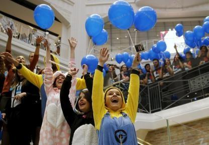 Workers react during the inauguration of Primark's new Spanish flagship store in Madrid
