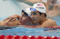Jay Litherland, of the United States, embraces teammate Chase Kalisz, right, after the final of the men's 400-meter individual medley at the 2020 Summer Olympics, Sunday, July 25, 2021, in Tokyo, Japan. (AP Photo/Matthias Schrader)