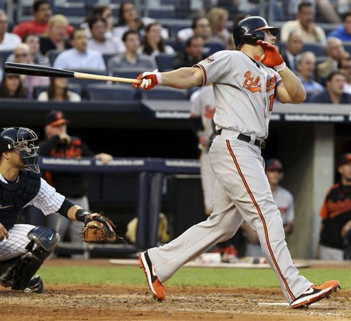 Baltimore Orioles' Chris Davis hits a grand slam during the second inning of a baseball game against the New York Yankees, Tuesday, July 31, 2012, at Yankee Stadium in New York. (AP Photo/Seth Wenig)