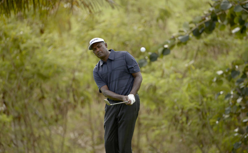 Fiji's Vijay Singh hits a shot during a practice round in Nadi ahead of the Fiji International golf tournament, August 12, 2014