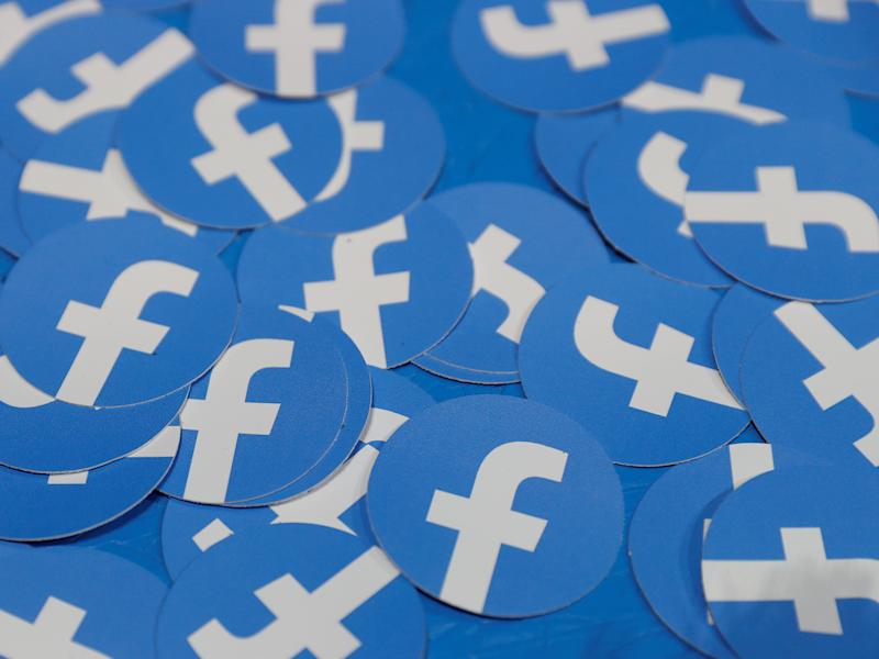 FILE PHOTO: Stickers bearing the Facebook logo are pictured at Facebook Inc's F8 developers conference in San Jose, California, U.S., April 30, 2019. REUTERS/Stephen Lam