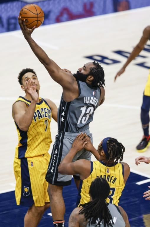 Brooklyn's James Harden goes up for a shot over Indiana's Malcolm Brogdon inthe Nets' 124-115 NBA victory over the Pacers