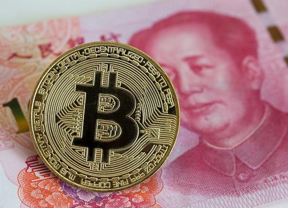 Even the Chinese government can't stop people from using yuan to buy bitcoin. (Getty)