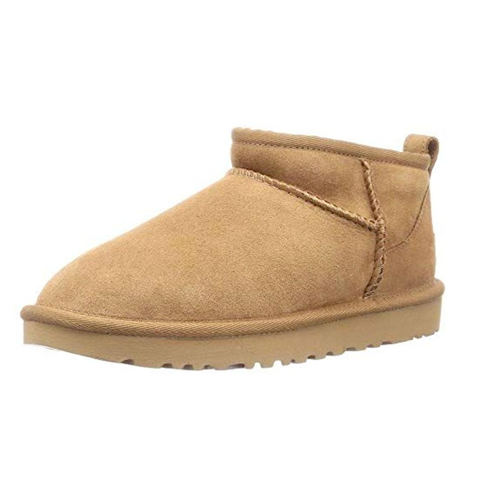 """<p><strong>UGG</strong></p><p>amazon.com</p><p><strong>$139.95</strong></p><p><a href=""""https://www.amazon.com/dp/B082HHVFLX?tag=syn-yahoo-20&ascsubtag=%5Bartid%7C10049.g.37222274%5Bsrc%7Cyahoo-us"""" rel=""""nofollow noopener"""" target=""""_blank"""" data-ylk=""""slk:Shop Now"""" class=""""link rapid-noclick-resp"""">Shop Now</a></p><p>You might never see your spouse without these floofy bbs on ever again. They're that comfy.</p>"""
