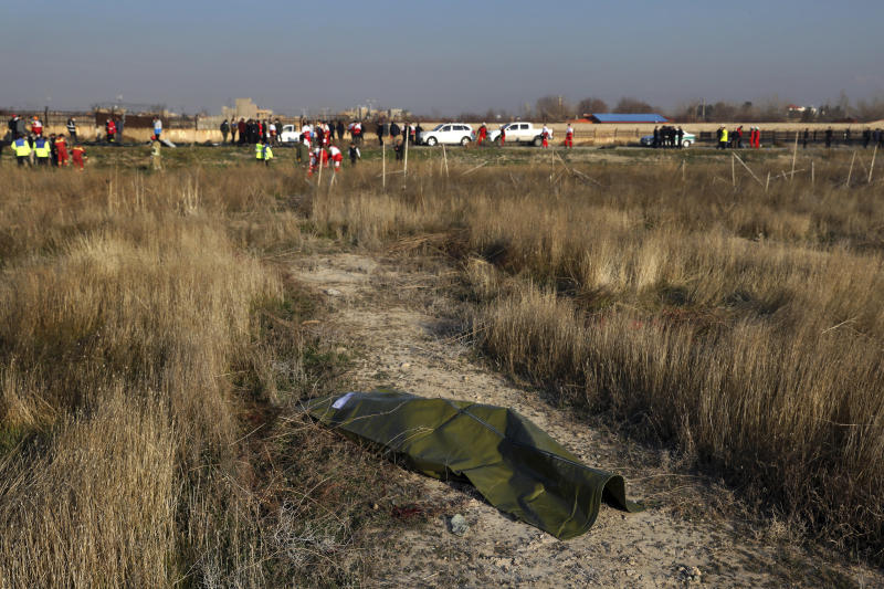 The body of a victim of a Ukrainian plane crash lies on the ground in Shahedshahr, southwest of the capital Tehran, Iran, Wednesday, Jan. 8, 2020. (Photo: Ebrahim Noroozi/AP)