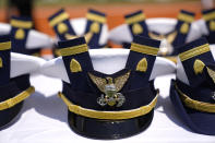 Hats are displayed on a table during the commencement for the United States Coast Guard Academy in New London, Conn., Wednesday, May 19, 2021. (AP Photo/Andrew Harnik)