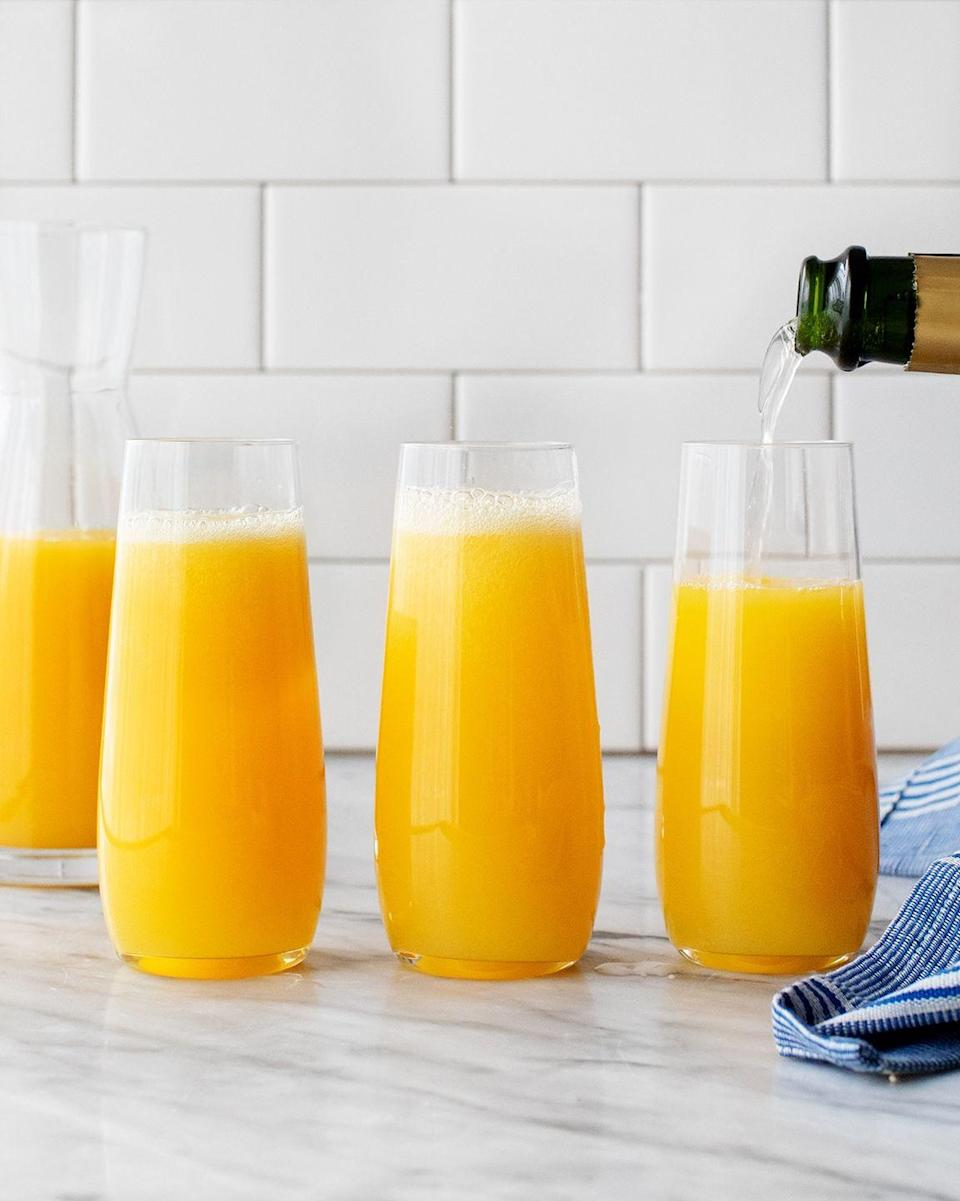 """<p>Nail the classic brunch drink on Christmas morning by following this recipe, which details the *real* ratio of orange juice to Champagne. <br></p><p><em>Get the recipe at <a href=""""https://www.loveandlemons.com/mimosa-recipe/"""" rel=""""nofollow noopener"""" target=""""_blank"""" data-ylk=""""slk:Love and Lemons"""" class=""""link rapid-noclick-resp"""">Love and Lemons</a>. </em></p>"""