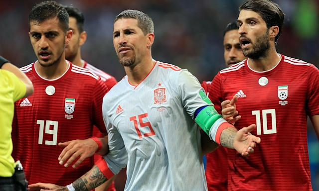Sergio Ramos talks to the referee during Spain's 1-0 win over Iran.