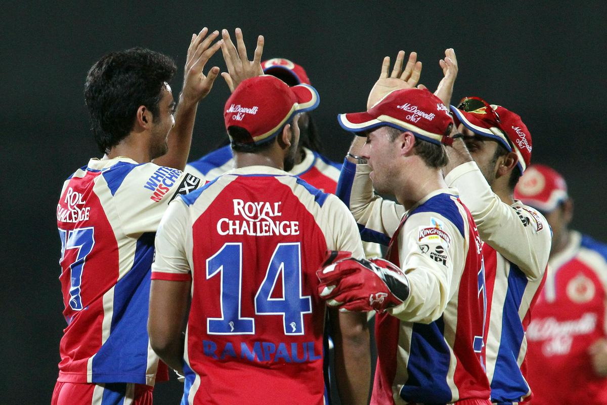 Jaidev Unadkat of the Royal Challengers Bangalore is congratulated for getting Mahela Jayawardene of Delhi Daredevils wicket during match 57 of the Pepsi Indian Premier League between Delhi Daredevils and the Royal Challengers Bangalore held at the Feroz Shah Kotla Stadium, Delhi on the 10th May 2013. (BCCI)