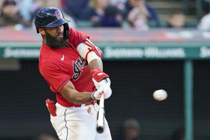 Cleveland Indians' Amed Rosario hits an RBI-single in the fourth inning of a baseball game against the Baltimore Orioles, Tuesday, June 15, 2021, in Cleveland. (AP Photo/Tony Dejak)