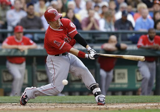 Los Angeles Angels' Collin Cowgill swings and misses to strike out against the Seattle Mariners in the second inning of a baseball game Friday, July 12, 2013, in Seattle. (AP Photo/Elaine Thompson)