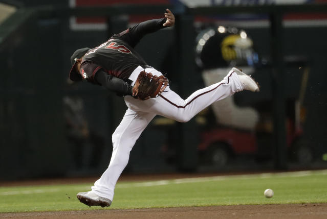 Arizona Diamondbacks Eduardo Escobar cannot stop a double hit by Milwaukee Brewers' Christian Yelich during the fourth inning of a baseball game, Saturday, July 20, 2019, in Phoenix. (AP Photo/Matt York)