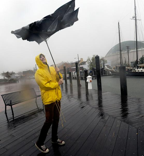 Jake Wilkerson, 20, of Annapolis, Md., struggles with his umbrella as Hurricane Sandy approaches Annapolis Monday, Oct. 29, 2012. Hurricane Sandy continued on its path Monday, as the storm forced the shutdown of mass transit, schools and financial markets, sending coastal residents fleeing, and threatening a dangerous mix of high winds and soaking rain. (AP Photo/Steve Ruark)