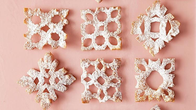 """<p>For this festive holiday treat, wonton wrappers are cut into a snowflake-like shape, then shallow fried in a cast-iron skillet until crispy. Dust with confectioners' sugar for serving. <a href=""""https://www.marthastewart.com/1523960/sweet-snowflake-crisps"""" rel=""""nofollow noopener"""" target=""""_blank"""" data-ylk=""""slk:View recipe"""" class=""""link rapid-noclick-resp""""> View recipe </a></p>"""
