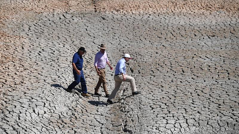 The Treasurer hinted at more cash flows to farmers, as he toured drought-parched areas in QLD