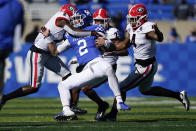 Georgia defensive back Richard LeCounte (2) tackles Kentucky quarterback Joey Gatewood (2) during the first half of an NCAA college football game, Oct. 31, 2020, in Lexington, Ky. (AP Photo/Bryan Woolston)