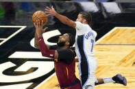 Orlando Magic guard Michael Carter-Williams (7) blocks a shot by Cleveland Cavaliers center Andre Drummond, left, during the second half of an NBA basketball game, Monday, Jan. 4, 2021, in Orlando, Fla. (AP Photo/John Raoux)
