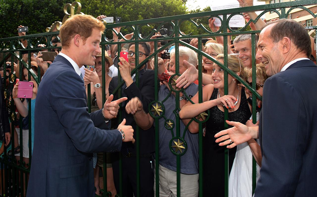 SYDNEY, AUSTRALIA - OCTOBER 05: Prince Harry greets well wishers at Kirribilli House on October 5, 2013 in Sydney, Australia. Over 50 ships participate in the International Fleet Review at Sydney Harbour to commemorate the 100 year anniversary of the Royal Australian Navy's fleet arriving into Sydney. Prince Harry is an official guest of the Australian Government and will take part in the fleet review during his two-day visit to Australia. (Photo by William West-Pool/Getty Images)