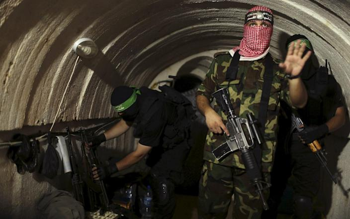 A file photo shows a Palestinian fighter in an underground tunnel in Gaza in 2014 - Reuters