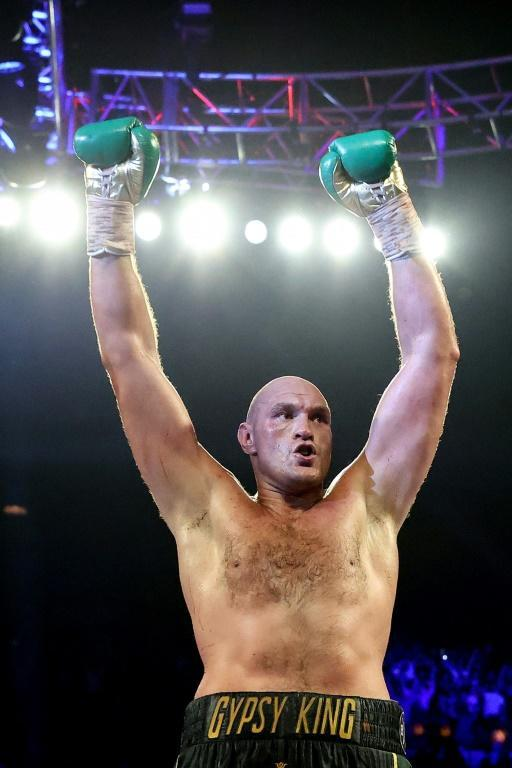 Tyson Fury celebrates his seventh-round TKO triumph in his WBC heavyweight world title rematch against Deontay Wilder (AFP Photo/AL BELLO)