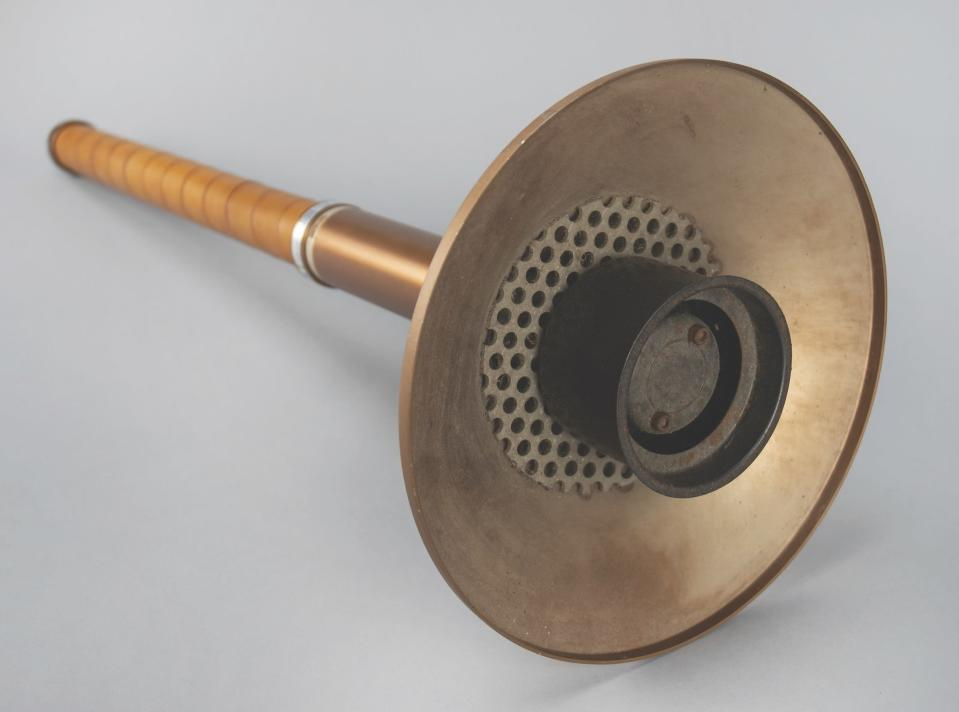 In this photo provided by RR Auction of Boston, an Olympic torch from the Lake Placid 1980 Winter Olympics is shown. Olympic medals dating to 1896, relay torches from several eras, and other Olympic memorabilia are among the items being auctioned by RR Auction, just 10 days before the start of the Tokyo games. (Nikki Brickett/RR Auction via AP)