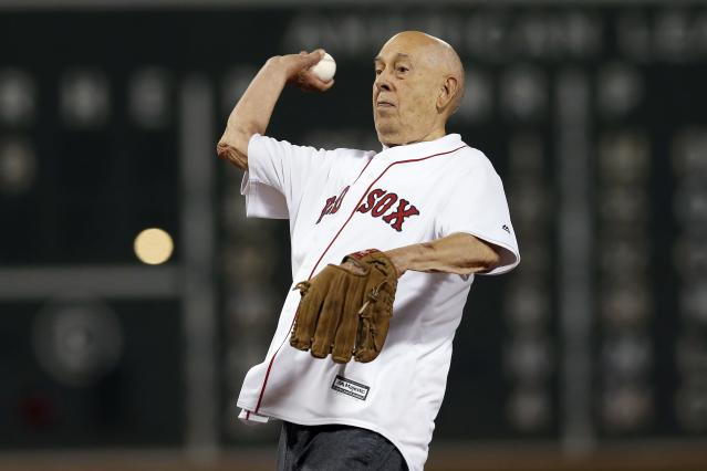 Founder of ESPN Bill Rasmussen throws out the ceremonial first pitch before a baseball game between the Boston Red Sox and the New York Yankees in Boston, Sunday, Sept. 8, 2019. (AP Photo/Michael Dwyer)