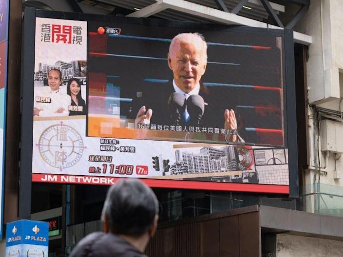 A man watches a report of Biden's inauguration in Hong Kong