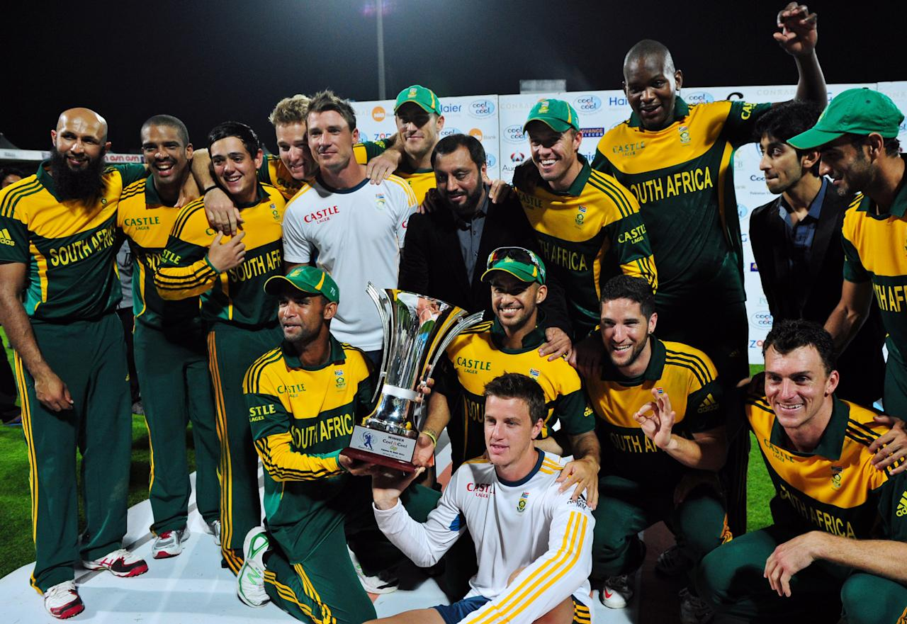 South African cricket players pose with their trophy after they won the five-match series against Pakistan in Sharjah Cricket Stadium in Sharjah on November 11, 2013. South Africa beat Pakistan by 117 runs in the fifth and final day-night international in Sharjah on Monday, clinching the five-match series 4-1.   AFP PHOTO/ASIF HASSAN        (Photo credit should read ASIF HASSAN/AFP/Getty Images)