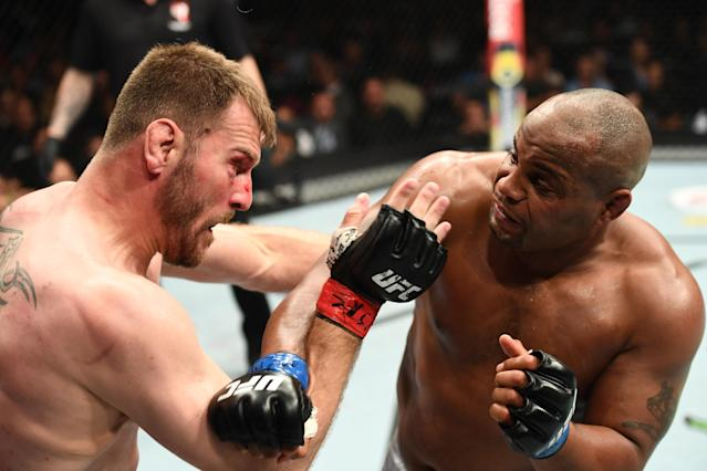 Unlike his rival Jon Jones, Cormier (R) has made a career out of fighting much larger opponents (Getty Images).