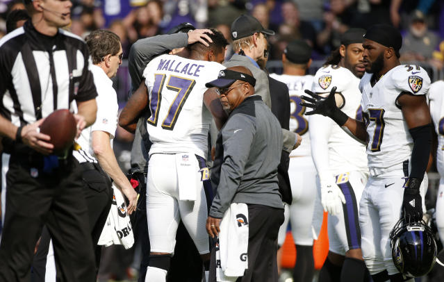 """Ravens wide receiver <a class=""""link rapid-noclick-resp"""" href=""""/nfl/players/9348/"""" data-ylk=""""slk:Mike Wallace"""">Mike Wallace</a> (17) is helped off the field after a hit from Vikings safety <a class=""""link rapid-noclick-resp"""" href=""""/nfl/players/24759/"""" data-ylk=""""slk:Andrew Sendejo"""">Andrew Sendejo</a>. (AP)"""
