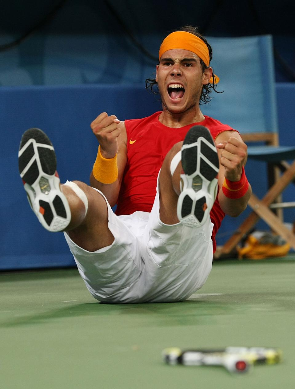 BEIJING - AUGUST 15: Rafael Nadal of Spain celebrates after defeating Novak Djokovic of Serbia in the men's semifinal tennis match at the Olympic Green Tennis Center on Day 7 of the Beijing 2008 Olympic Games on August 15, 2008 in Beijing, China. (Photo by Nick Laham/Getty Images)