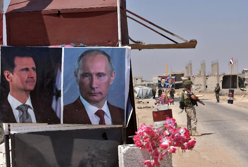 In Syria, photos of Russian President Vladimir Putin hang alongside those of Syrian leader Bashar al-Assad, since Moscow intervened on the side of the Damascus regime in 2015 (AFP Photo/George OURFALIAN)