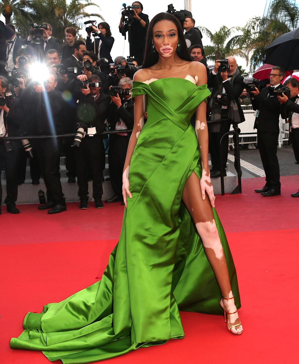<p>Model Winnie Harlow demanded attention on the Cannes red carpet in green, satin Ralph and Russo. [Photo: Getty] </p>