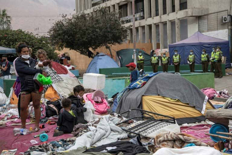 Thousands of illegal migrants, mainly Venezuelan families, started arriving in Iquique a year ago (AFP/MARTIN BERNETTI)
