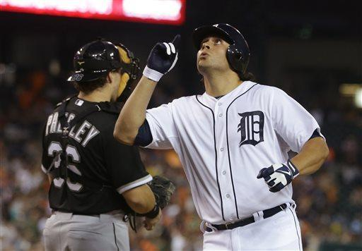 Detroit Tigers' Matt Tuiasosopo looks skyward after scoring on a solo home run off Chicago White Sox starting pitcher Jose Quintana during the fifth inning of a baseball game in Detroit, Tuesday, July 9, 2013. (AP Photo/Carlos Osorio)