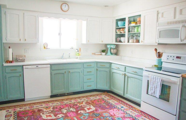 """<p>The mint green cabinets add a touch of whimsy to the kitchen, while the white overhead cabinets keep it looking fresh.</p><p><strong>Get the tutorial at <a href=""""https://hollandavenuehome.com/2017/01/27/before-after-a-bright-affordable-diy-kitchen-update/"""" rel=""""nofollow noopener"""" target=""""_blank"""" data-ylk=""""slk:Holland Avenue"""" class=""""link rapid-noclick-resp"""">Holland Avenue</a>.</strong></p><p><a class=""""link rapid-noclick-resp"""" href=""""https://www.amazon.com/Rust-Oleum-285139-Interior-Chalked-Serenity/dp/B00YSK43AG/?tag=syn-yahoo-20&ascsubtag=%5Bartid%7C2139.g.34085615%5Bsrc%7Cyahoo-us"""" rel=""""nofollow noopener"""" target=""""_blank"""" data-ylk=""""slk:SHOP CHALK PAINT"""">SHOP CHALK PAINT</a></p>"""