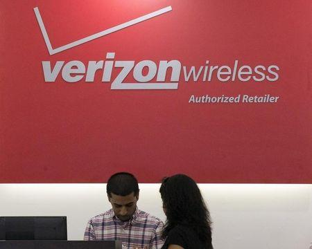 A woman is cashed out at a Verizon store in New York's financial district