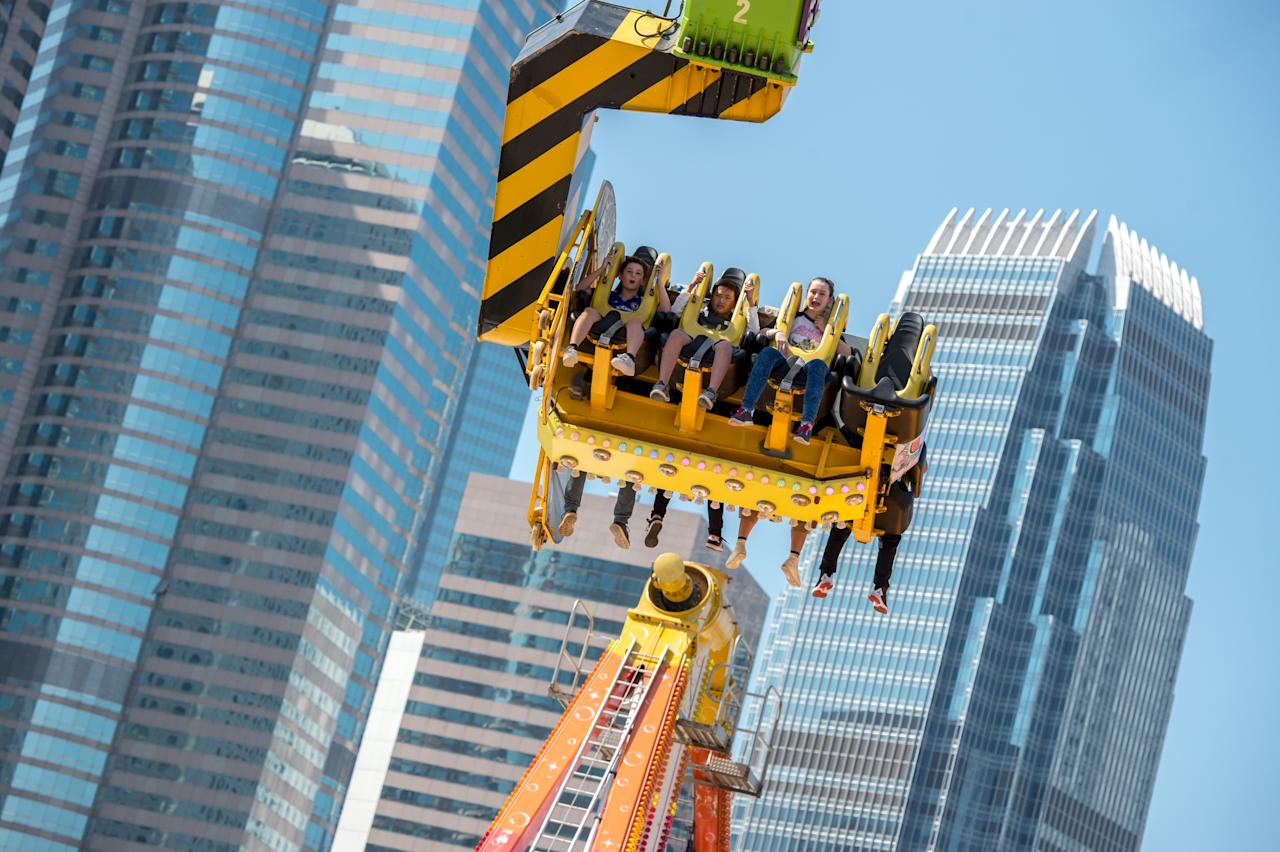 <p>Booster Maxx – the tallest ride stands at 55m tall, higher than the Supertrees at Gardens by the Bay. (Photo: Prudential Marina Bay Carnival) </p>